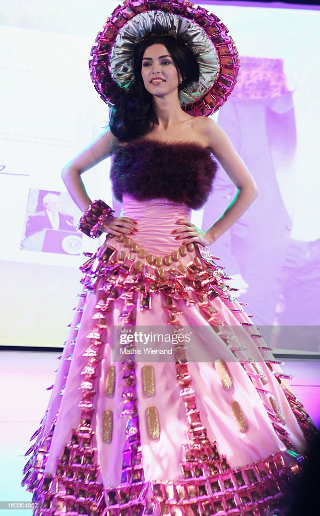 A model wearing creations out of Cake packagins by artist Larisa Katz Art couture walks the catwalk during the Lambertz Monday Night at Alter Wartesaal on January 28, 2013 in Cologne, Germany.