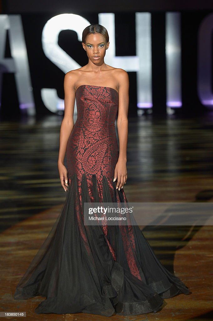 A model wearing David Tlale walks the runway during the 3rd Annual United Colors Of Fashion Gala at Lexington Avenue Armory on October 9, 2013 in New York City.