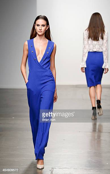 A model wearing DeMartini is seen walking the runway during the Fashion Palette Australia show during New York Fashion Week Spring 2015 at Pier 59 on...
