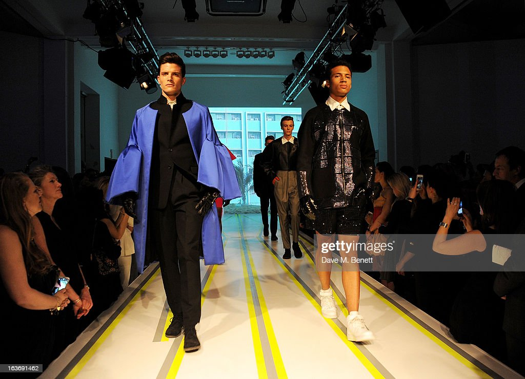 A model wearing designs by Hiroaki Kanai walks the runway at the Swarovski Whitechapel Gallery Art Plus Fashion fundraising gala in support of the gallery's education fund at The Whitechapel Gallery on March 14, 2013 in London, England.