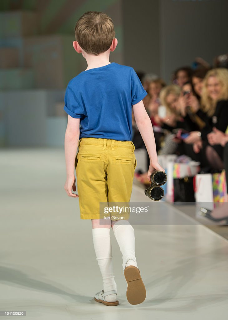 A model wearing Finger in the Nose Spring/Summer '13 walks the runway at the Global Kids Fashion Week SS13 public show in aid of Kids Company at The Freemason's Hall on March 20, 2013 in London, England.