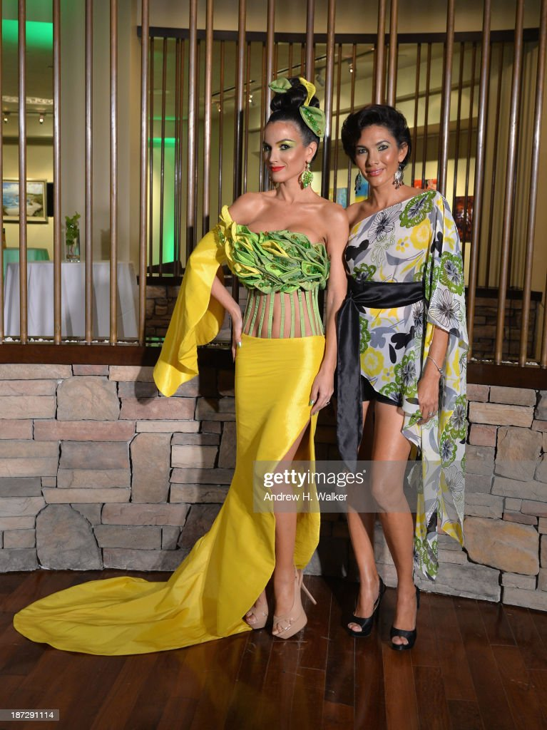 A model wearing Gigliola Designs poses with Designer Gigliola Gomez at the Aruba In Style 2013 Kick-Off party at Westin Aruba Resort on November 7, 2013 in Aruba, Aruba.