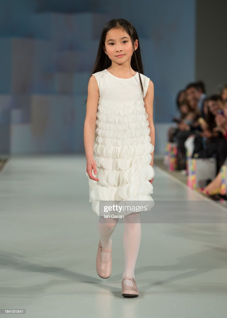 A model wearing I Pinco Pallino Spring/Summer '13 walks the runway at the Global Kids Fashion Week SS13 public show in aid of Kids Company at The Freemason's Hall on March 20, 2013 in London, England.