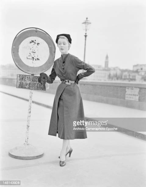 A model wearing Italian fashions by the River Arno in Florence Italy 21st July 1951