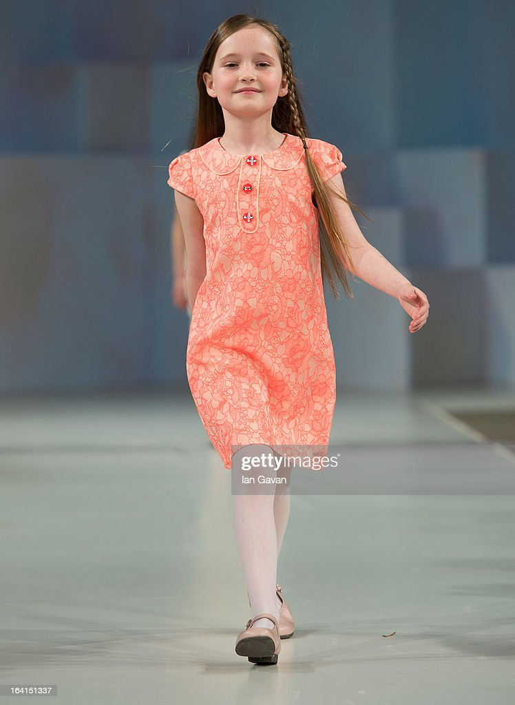 A model wearing Kenzo Spring/Summer '13 walks the runway at the Global Kids Fashion Week SS13 public show in aid of Kids Company at The Freemason's Hall on March 20, 2013 in London, England.