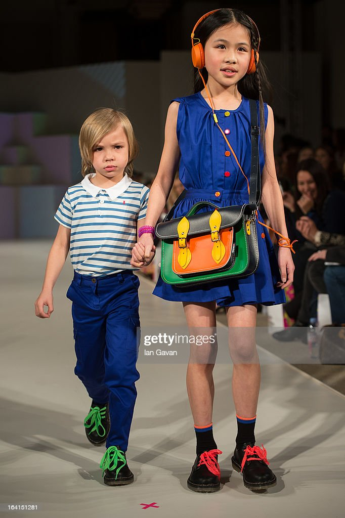 A model wearing Kickle by AlexandAlexa Spring/Summer '13 walks the runway at the Global Kids Fashion Week SS13 public show in aid of Kids Company at The Freemason's Hall on March 20, 2013 in London, England.
