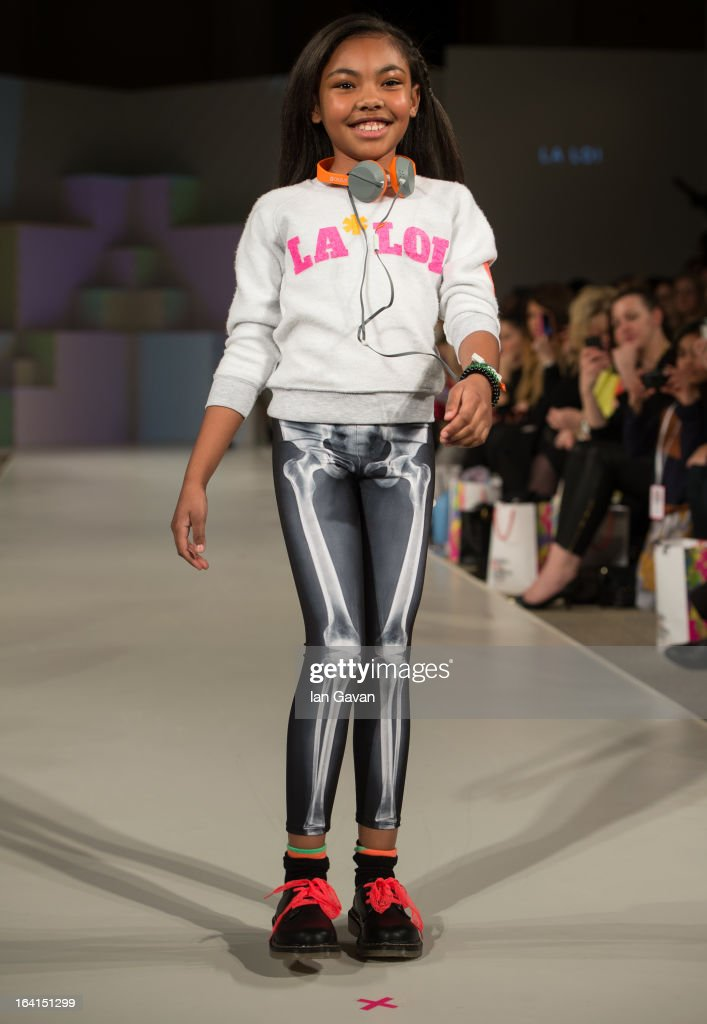 A model wearing La Loi Spring/Summer '13 walks the runway at the Global Kids Fashion Week SS13 public show in aid of Kids Company at The Freemason's Hall on March 20, 2013 in London, England.
