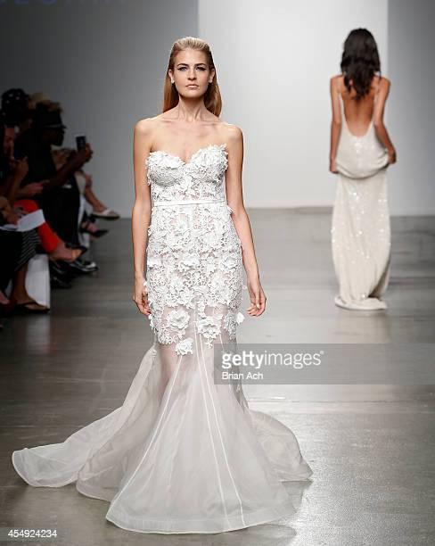 A model wearing Leah Da Gloria walks the runway during the Fashion Palette Australia runway show during New York Fashion Week Spring 2015 at Pier 59...
