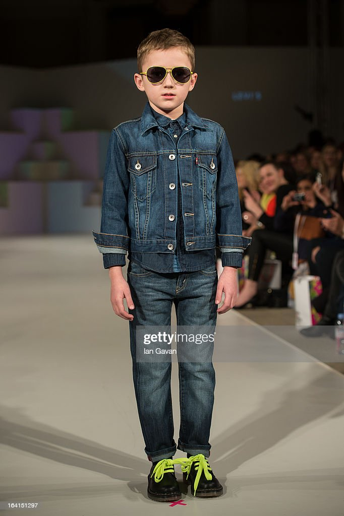 A model wearing Levi's Spring/Summer '13 walks the runway at the Global Kids Fashion Week SS13 public show in aid of Kids Company at The Freemason's Hall on March 20, 2013 in London, England.