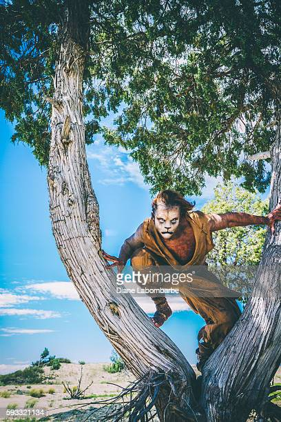 Model Wearing Lion Makeup & Costume  Leaping From A Tree