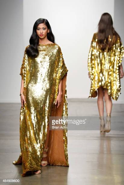 A model wearing Lisa Kelly is seen walking the runway during the Fashion Palette Australia show during New York Fashion Week Spring 2015 at Pier 59...