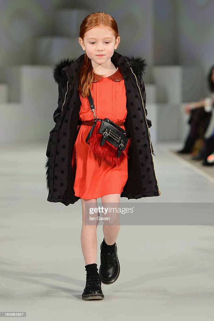 A model wearing Little Marc Jacobs Look 4 Autumn/Winter '13 walks the runway at the Global Kids Fashion Week AW13 media and VIP show at The Freemason's Hall on March 19, 2013 in London, England.