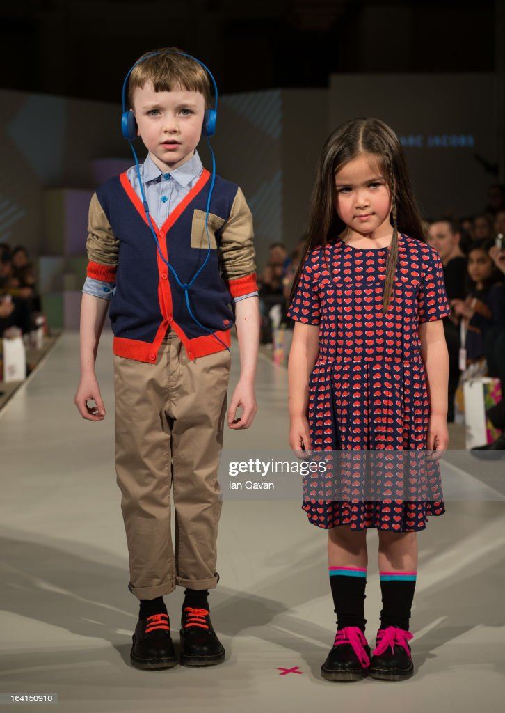 A model wearing Little Marc Jacobs Spring/Summer '13 walks the runway at the Global Kids Fashion Week SS13 public show in aid of Kids Company at The Freemason's Hall on March 20, 2013 in London, England.