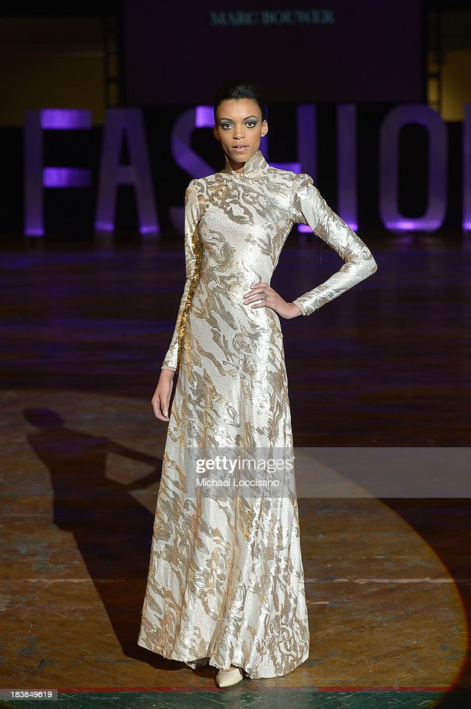 A model wearing Marc Bouwer walks the runway during the 3rd Annual United Colors Of Fashion Gala at Lexington Avenue Armory on October 9, 2013 in New York City.