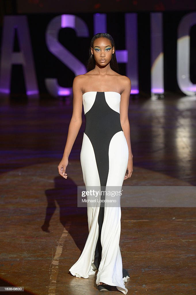 A model wearing Marc Bouwer walks the runway during the 3rd Annual United Colors Of Fashion Gala at Lexington Avenue Armory on October 9 2013 in New...