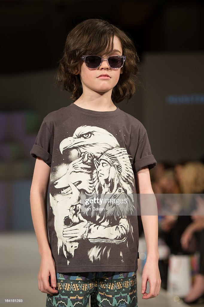 A model wearing Munster Kids Spring/Summer '13 walks the runway at the Global Kids Fashion Week SS13 public show in aid of Kids Company at The Freemason's Hall on March 20, 2013 in London, England.