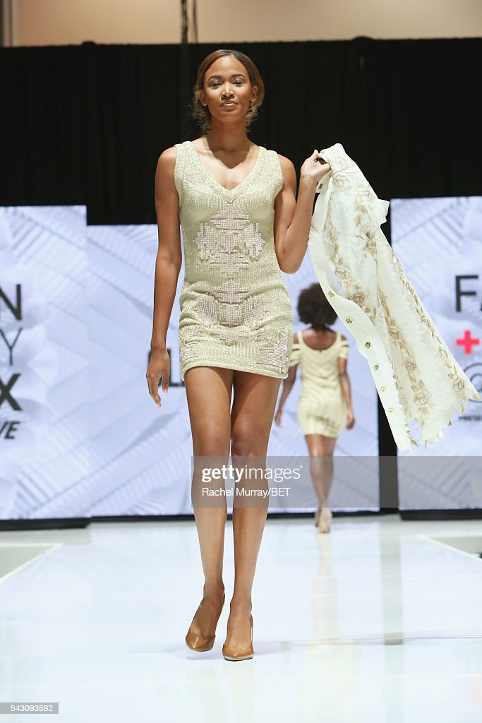 A model wearing Olena Dat's walks the runway at the Fashion & Beauty @ BETX sponsored by Progressive fashion show during the 2016 BET Experience on June 25, 2016 in Los Angeles, California.