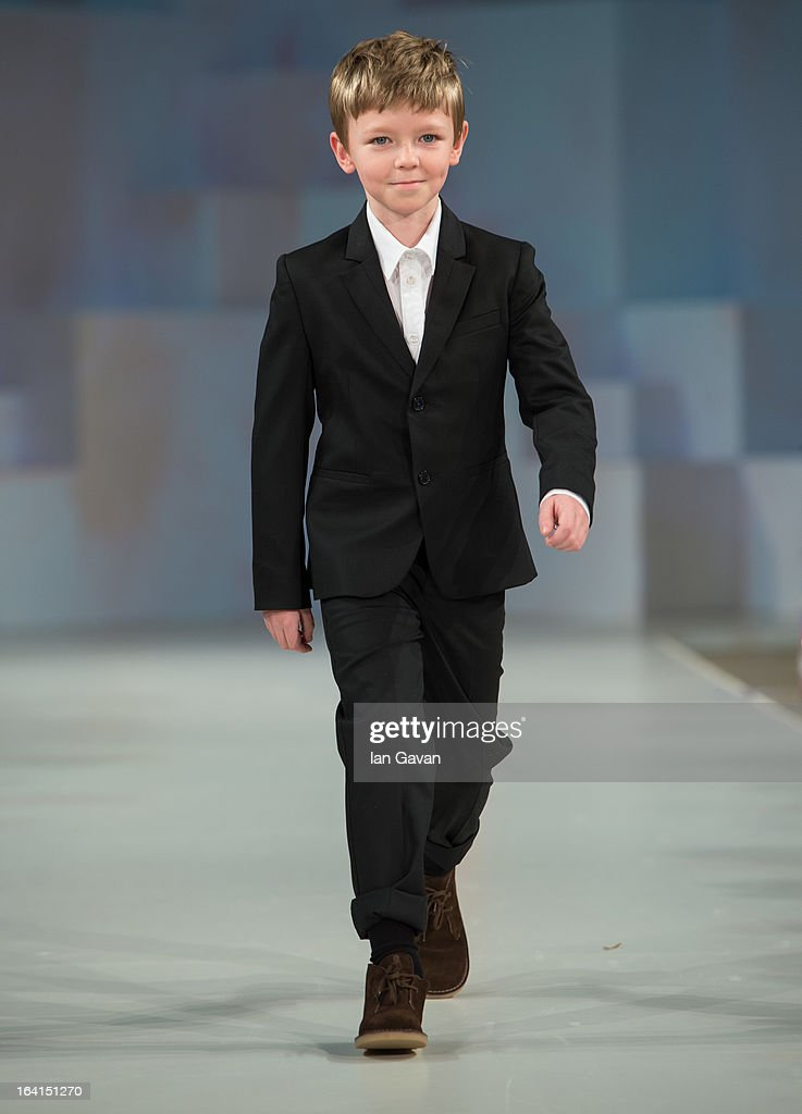 A model wearing Paul Smith Junior Spring/Summer '13 walks the runway at the Global Kids Fashion Week SS13 public show in aid of Kids Company at The Freemason's Hall on March 20, 2013 in London, England.