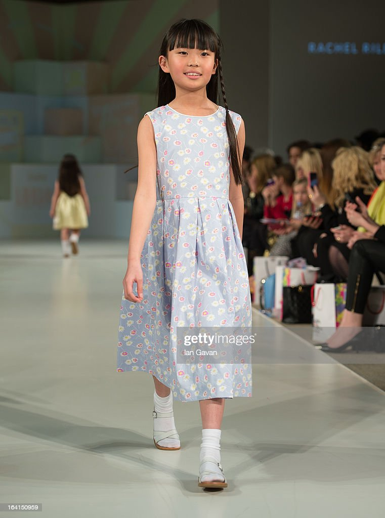 A model wearing Rachel Riley Spring/Summer '13 walks the runway at the Global Kids Fashion Week SS13 public show in aid of Kids Company at The Freemason's Hall on March 20, 2013 in London, England.