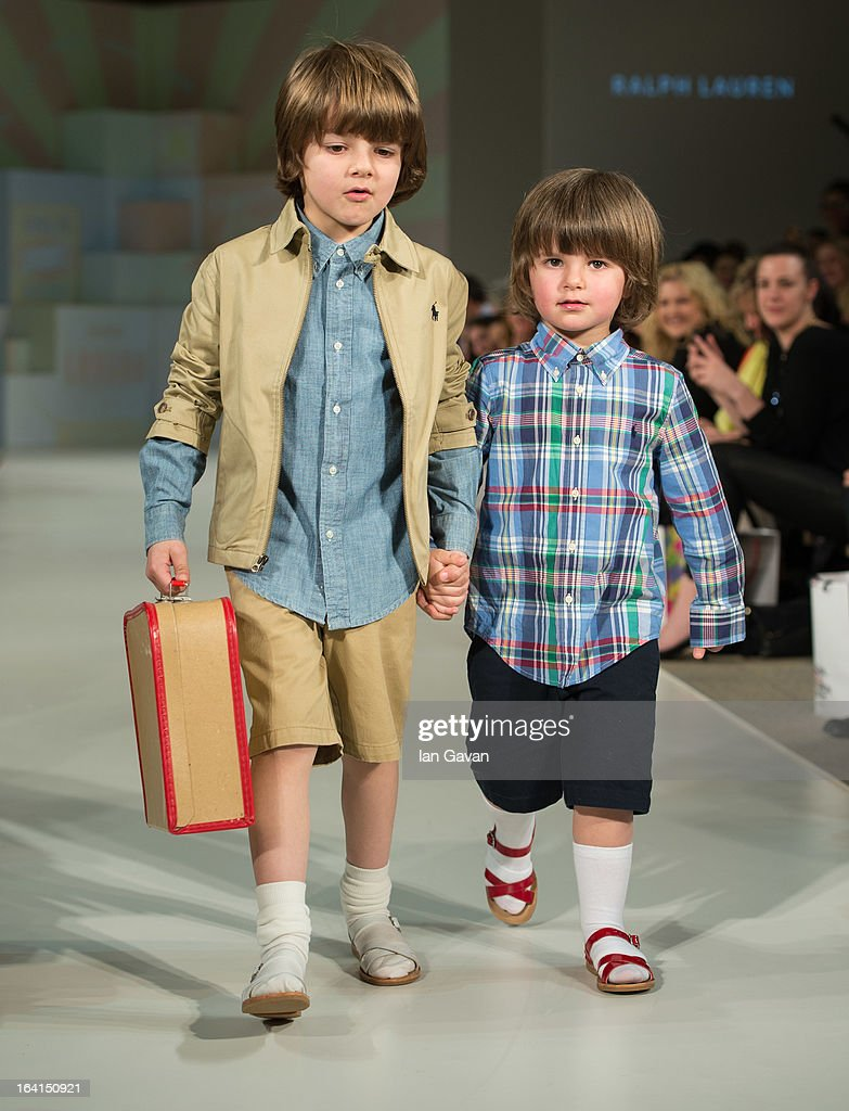 A model wearing Ralph Lauren Spring/Summer '13 walks the runway at the Global Kids Fashion Week SS13 public show in aid of Kids Company at The Freemason's Hall on March 20, 2013 in London, England.