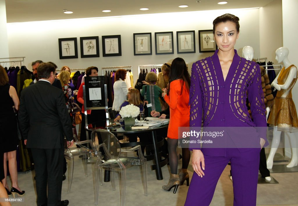 A model wearing Ralph Rucci Fall 2013 at Saks Fifth Avenue presents designer Ralph Rucci at Saks Fifth Avenue Beverly Hills on March 22, 2013 in Beverly Hills, California.