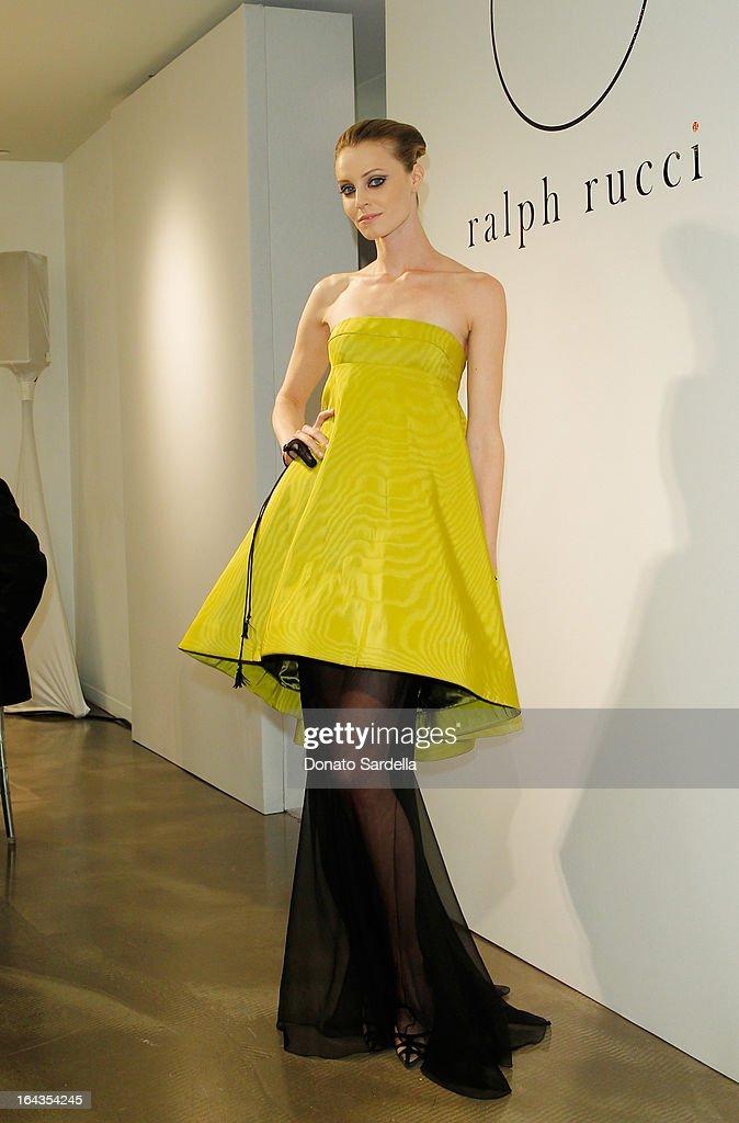 A model wearing Ralph Rucci Fall 2013 at Saks Fifth Avenue presents designer Ralph Rucci at Saks Fifth Avenue Beverly Hills on March 22, 2013 in Beverly Hills, California.