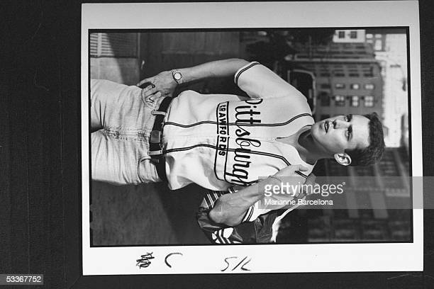 Model wearing reproduction baseball jersey of defunct minor league team Pittsburgh Crawfords manufactured by Ebbets Fields Flannels selling at...