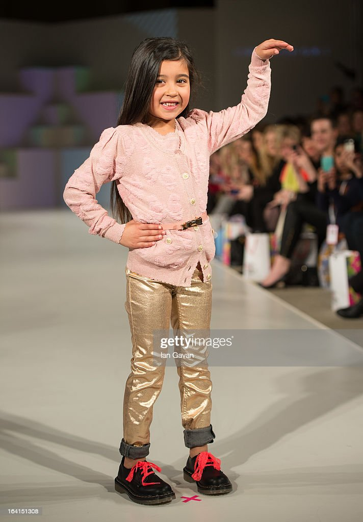 A model wearing SuperTrash Girls Spring/Summer '13 walks the runway at the Global Kids Fashion Week SS13 public show in aid of Kids Company at The Freemason's Hall on March 20, 2013 in London, England.