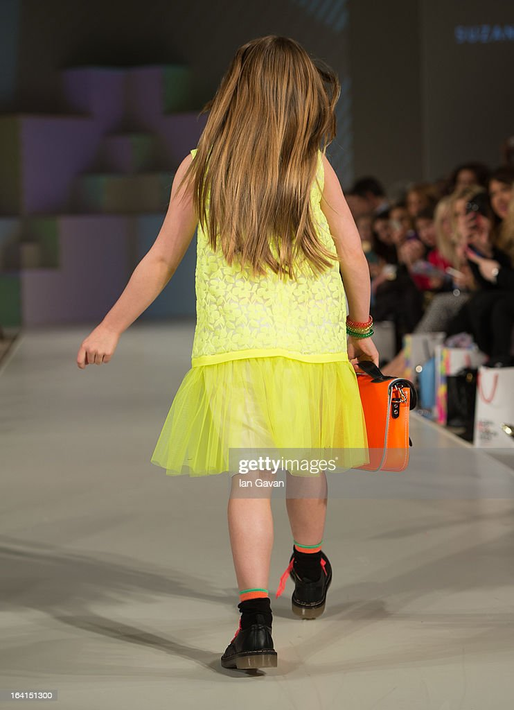 A model wearing Suzanne Ermann Spring/Summer '13 walks the runway at the Global Kids Fashion Week SS13 public show in aid of Kids Company at The Freemason's Hall on March 20, 2013 in London, England.