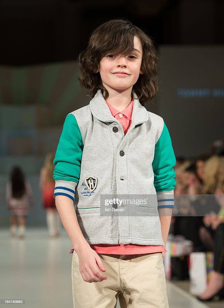 A model wearing Tommy Hilfiger Spring/Summer '13 walks the runway at the Global Kids Fashion Week SS13 public show in aid of Kids Company at The Freemason's Hall on March 20, 2013 in London, England.