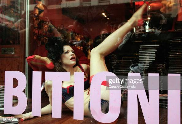A model wearing underwear by luxury lingerie brand Agent Provocateur performs in a live window display to mark tomorrow's publication of new book...