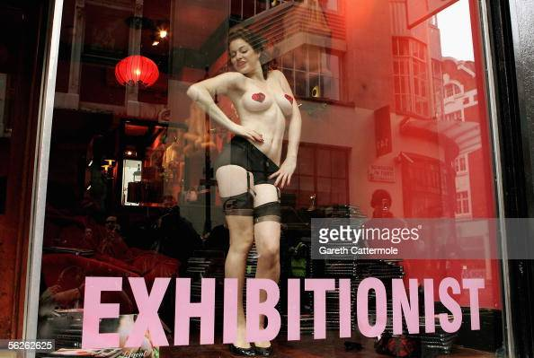 A model wearing underwear by luxury lingerie brand Agent Provocateur performs in a live window display to marks tomorrow's publication of new book...