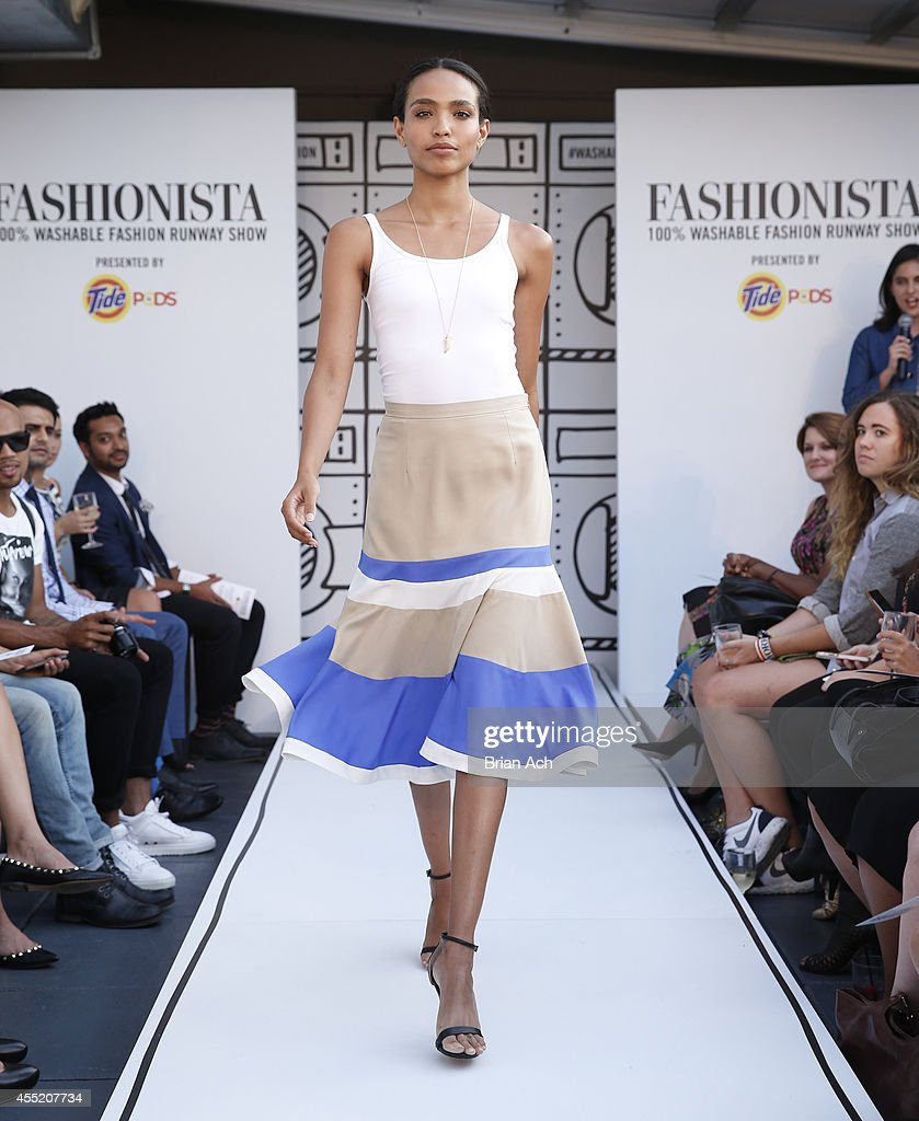A model wearing washable fashion walks the runway during the Fashionista And Tide Event at Empire Hotel Rooftop on September 10 2014 in New York City