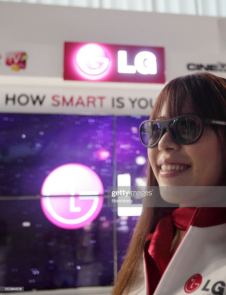 A model wears 3-D glasses at the LG Electronics Inc. booth at the Tokyo Game Show 2012 at Makuhari Messe in Chiba, Japan, on Thursday, Sept. 20, 2012. The show will be held through Sept. 23. Photographer: Tomohiro Ohsumi/Bloomberg via Getty Images