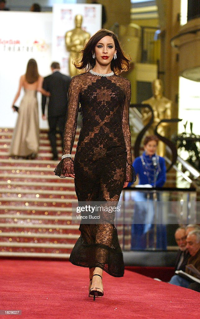 A model wears a black lace gown by designer Hylan Booker at the 2003 Oscar Fashion Preview at the Kodak Theatre on March 4, 2003 in Hollywood, California.