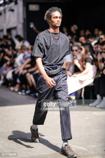 A model wears a black tshirt black pants outside the Y/Project show during Paris Fashion Week Menswear Spring/Summer 2018 on June 21 2017 in Paris...