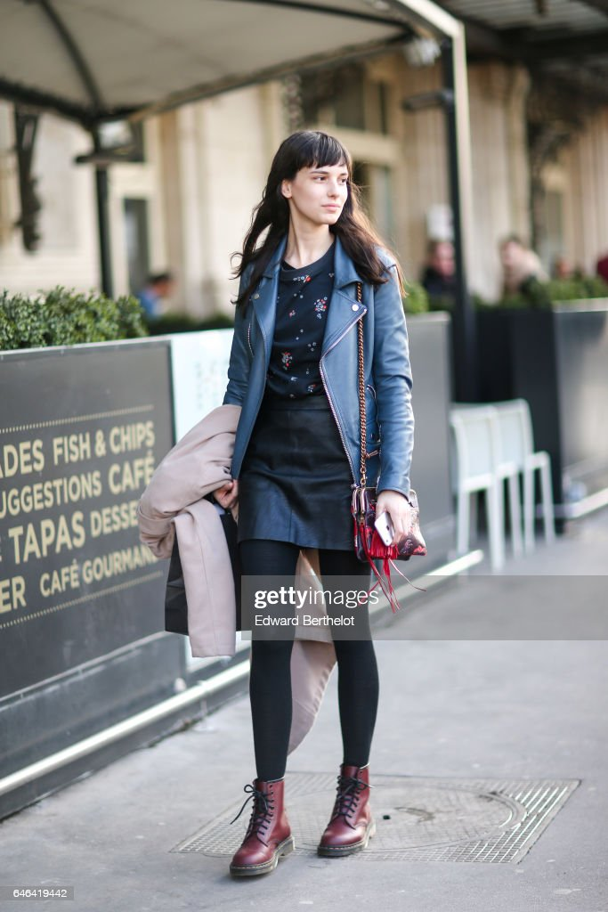 A model wears a blue jacket, a red bag, a balck skirt, and brown boots, outside the Olivier Theyskens show, during Paris Fashion Week Womenswear Fall/Winter 2017/2018, on February 28, 2017 in Paris, France.