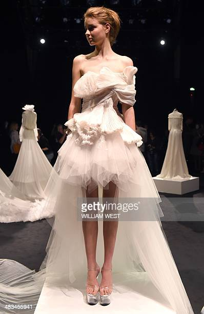 A model wears a bridal outfit by Chinese designer Lan Yu at Fashion Week Australia in Sydney on April 9 2014 The fourday schedule will include a...