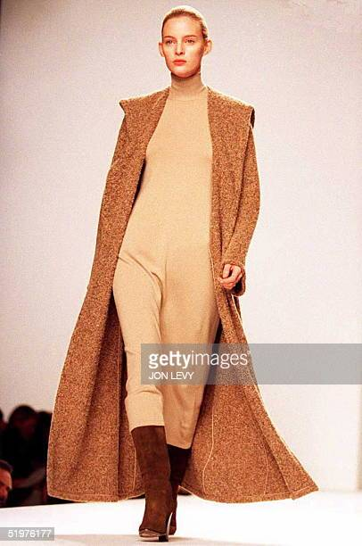A model wears a brown knit cape with a full cream dress in the Calvin Klein fall 1996 fashion show 01 April in New York The fall fashion shows...