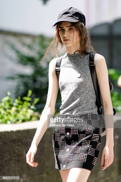 A model wears a cap a gray sleeveless top a skirt outside the 22/4 Hommes show during Paris Fashion Week Menswear Spring/Summer 2018 on June 23 2017...