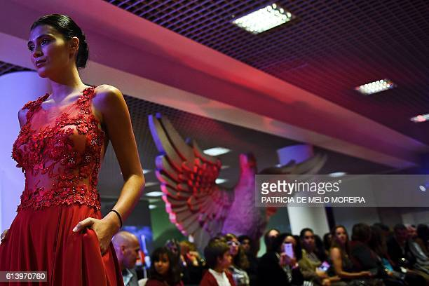 A model wears a creation by designer Micaela Oliveira during a presentation by Portuguese football club Benfica of 24 wedding dresses 12 evening...