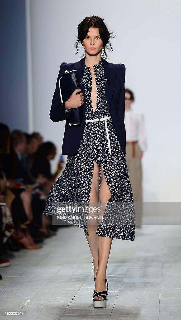 A model wears a creation by designer Michael Kors during the Mercedes-Benz Fashion Week Spring 2014 collection in New York on September 11, 2013. AFP PHOTO/Emmanuel Dunand