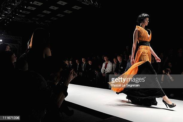 A model wears a creation by designer Svetlana Tegin on day 6 of the MercedesBenz Fashion Week Russia Fall/Winter 2011/2012 at the Congress Hall on...