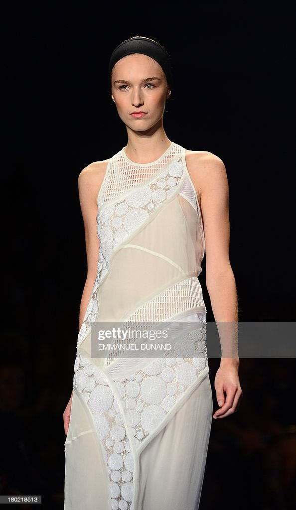 A model wears a creation by designer Vera Wang during the Mercedes-Benz Fashion Week Spring 2014 collection in New York on September 10, 2013. AFP PHOTO/Emmanuel Dunand