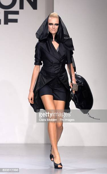 A model wears a creation by designers Maki Lofvander and Marcus Wilmont during London Fashion Week at Covent Garden Piazza London