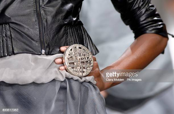 A model wears a creation by designers Marcus Wilmont and Maki Lofvander during London Fashion Week at Covent Garden Piazza London