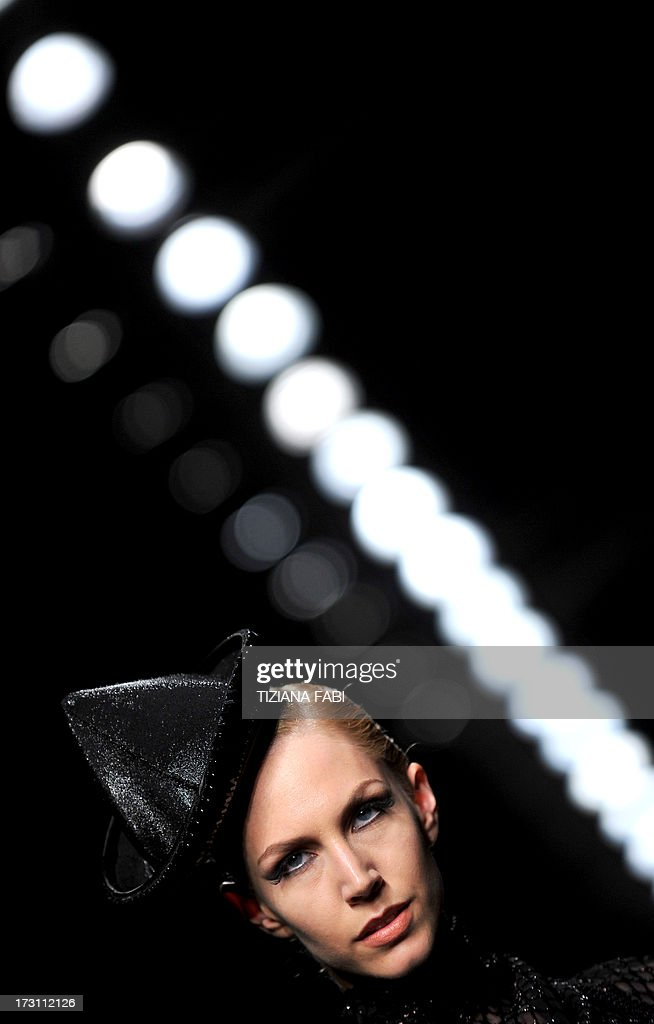 A model wears a creation by French designer Jean Paul Gaultier during a fashion show as part of the AltaModa Fashion Week at Santo Spirito In Sassia in Rome, on July 7, 2013. AFP PHOTO / TIZIANA FABI