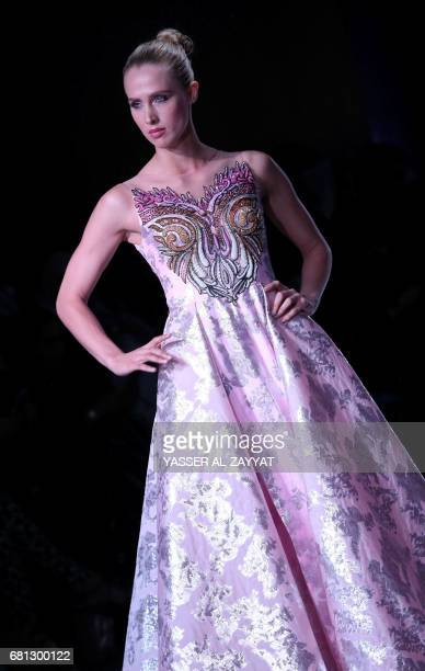 A model wears a creation by Kuwaiti designer Haya alBagaily during the Kuwait international fashion week in Kuwait City on May 92017 / AFP PHOTO /...