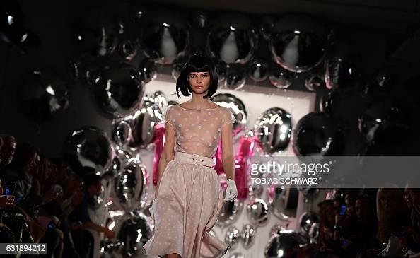 TOPSHOT A model wears a creation by Lena Hoschek at the Berlin Fashion Week in Berlin on January 17 2017 / AFP / Tobias SCHWARZ