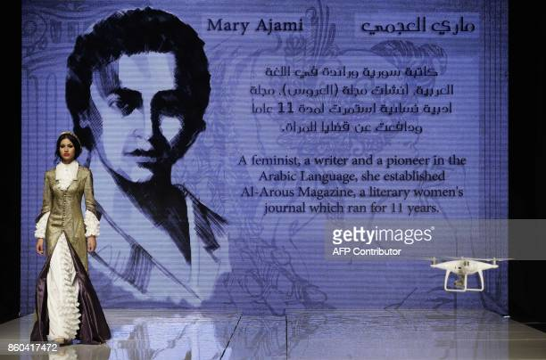 A model wears a creation inspired by feminist writer and pioneer in the Arabic language Mary Ajami by Syrian Fashion Designer Manal Ajaj during her...